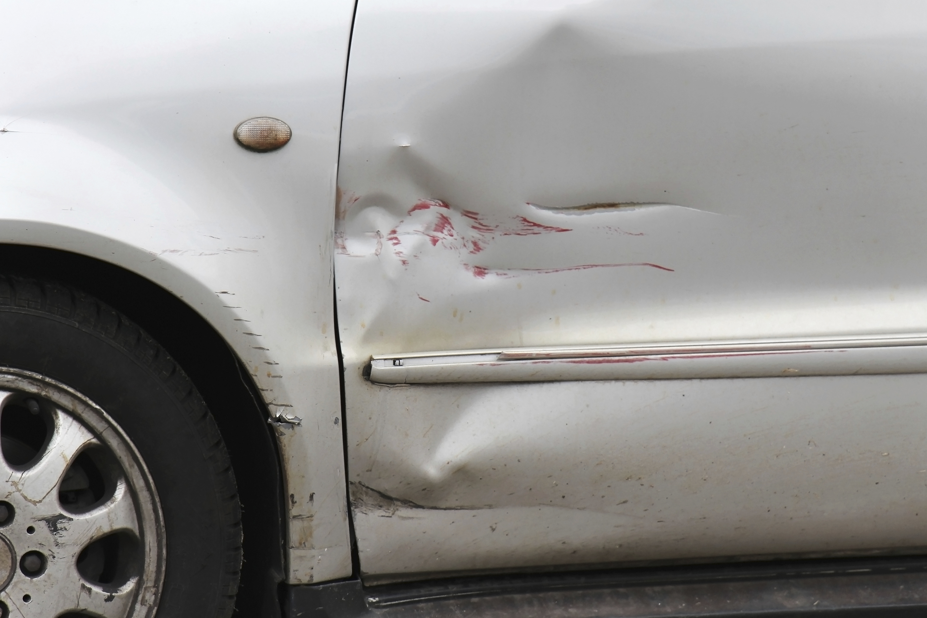 Should You Fix Dents and Scrapes in Your Older Car?