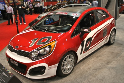 Kia Race Car and Surfer Themed Rios - SEMA Auto Show featured image large thumb0