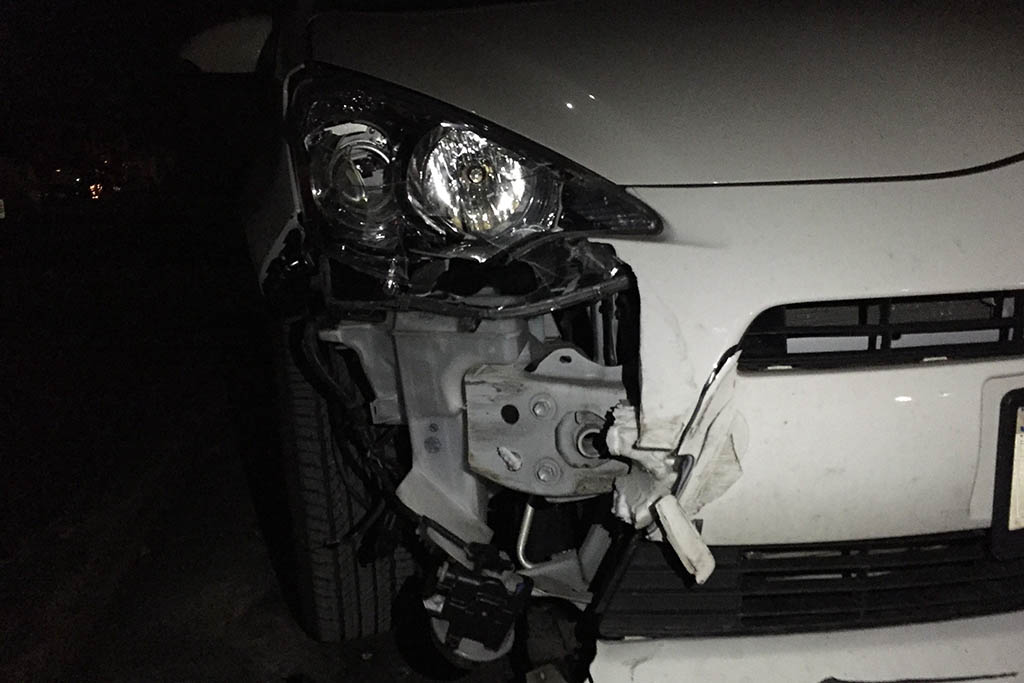 busted up Prius C