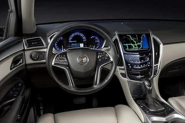 suv first cars view reviews review cadillac side look motor front trend
